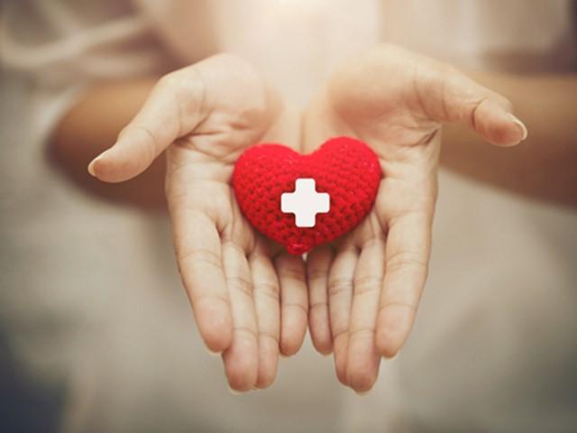 Hand giving red heart.jpg