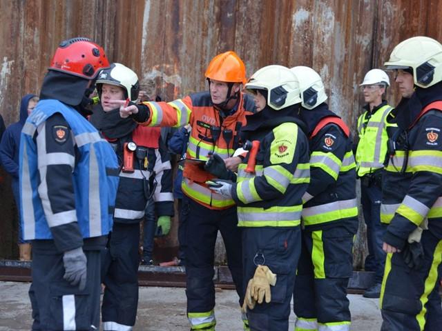 Overleg brandweermannen